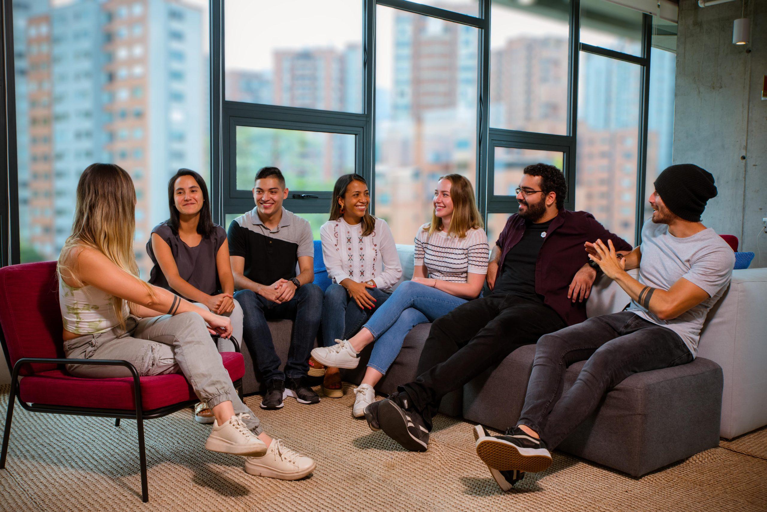 Team sat on sofa together talking